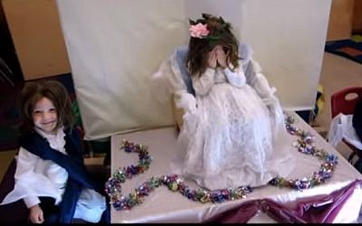 Little boys dressed as a bride and her mother in a reenactment of the marriage of the biblical characters Isaac and Rebecca. (YouTube screenshot)