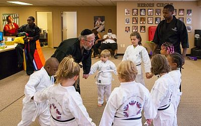 Rabbi Elimelech Goldberg leads a martial arts class for seriously ill children in Southfield, Michigan, August 2014. (photo credit: Joshua Schwartz Photography)