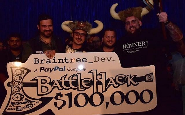 The AirHop team accepts the $100,000 prize from PayPal (Photo credit: Courtesy)