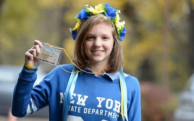 Anastasia, a young Jewish participant of Limmud FSU in Lviv, Ukraine, wears a flower head-piece known as 'vinok,' a symbol of Ukrainian culture, in Ukrainian colors. (photo credit: Yossi Aloni)