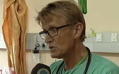 Norwegian doctor Mads Gilbert at Gaza's Shifa Hospital during 2014's Operation Protective Edge (screen capture: YouTube)