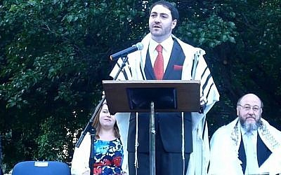 Chief Rabbi of Canberra, Australia Alon Meltzer giving a speech at his inauguration in November 2014. (screen capture: YouTube/Alon Meltzer)