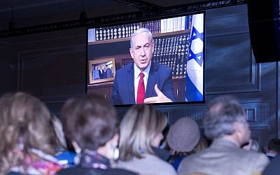 Prime Minister Benjamin Netanyahu addressing the Jewish Federations of North America's General Assembly in suburban Washington by video link, Nov. 11, 2014. (photo credit: Ron Sachs)