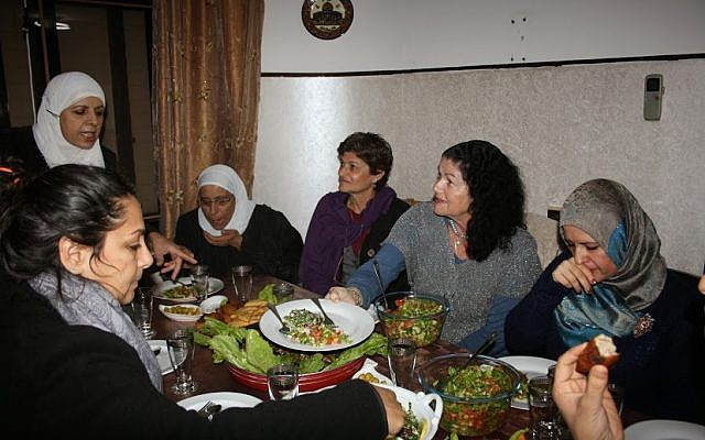 Jewish and Arab women meet for a joint cooking session organized by Givat Haviva )photo credit: courtesy/Givat Haviva)