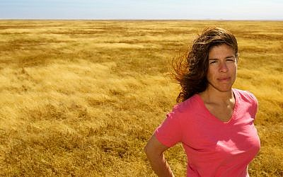 Afya founder and executive director Danielle Butin in the Serengeti. (photo credit: TJ Allan)