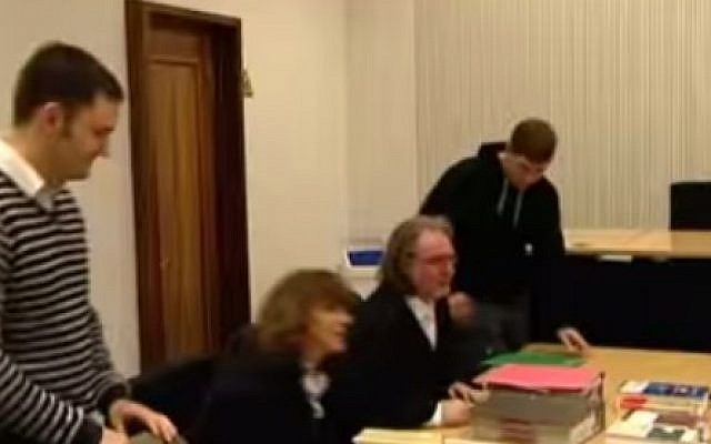 Dennis Giemsch (Left), a member of Dortmund's city council and the sole representative there of the far-right Die Recht party (Photo credit: Youtube screen capture)