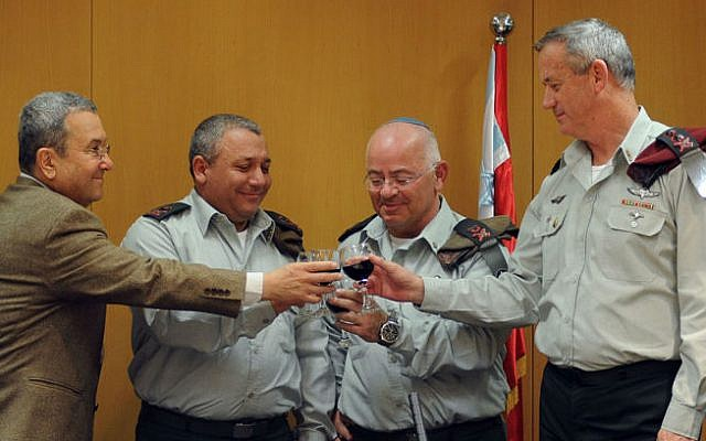 Eizenkot raising a toast with Gantz, Barak, and Maj. Gen. Yair Naveh, whom he replaced as Deputy Chief of the General Staff on January 14, 2013 (photo credit: IDF Spokesperson's Unit/ Flash 90)