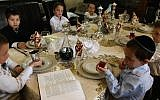 Children make kiddush at a model Passover seder (Nati Shohat/Flash90)