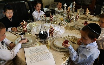Kids make kiddush (on Kedem grape juice?) at a model Passover seder (Photo credit: Nati Shohat/Flash90)