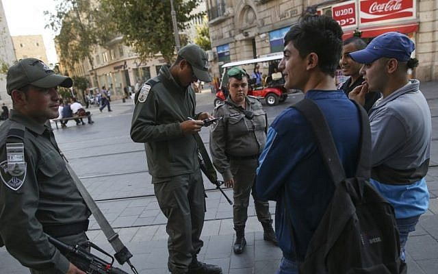 Israeli Border Police check the IDs of Palestinian teenagers on Jaffa Street in Jerusalem, October 23, 2014. (Nati Shohat/Flash90