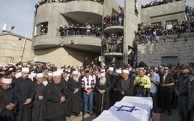 Mourners at the funeral of Israeli police officer Zidan Saif, 30, in the northern Druze village of Yanuh-Jat, on November 19, 2014 (photo credit: AFP/Jack Guez)