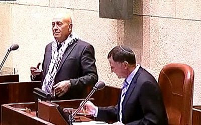 Balad MK Basel Ghattas and Knesset Speaker Yuli Edelstein on November 12, 2014 (photo credit: YouTube screenshot)