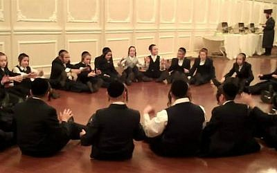 Hasidic school children practice a dance routine. (screen capture: YouTube)