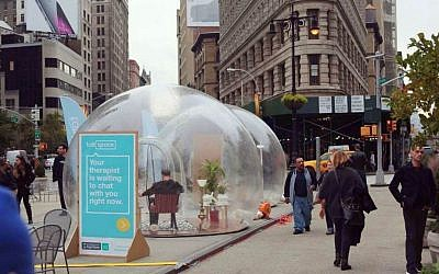 New York residents stroll past large transparent bubbles planted in Manhattan's Fifth Avenue by Israeli start up, Talkspace. November 12, 2014. (photo credit: courtesy)