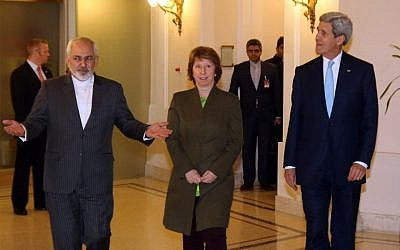 (From L) The Iranian Foreign Minister Mohammad Javad Zarif,former EU Foreign Policy Chief Catherine Ashton and US Secretary of State John Kerry arrive for nuclear talks in the Palais Coburg in Vienna on November 20, 2014.  (Photo credit: AFP PHOTO / POOL / RONALD ZAK)