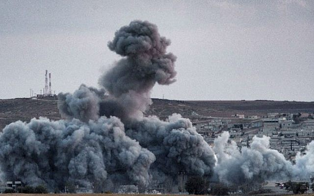Smoke rises above from Syrian Kurdish town of Kobani, on November 2, 2014 (photo credit: AFP/ Stringer)