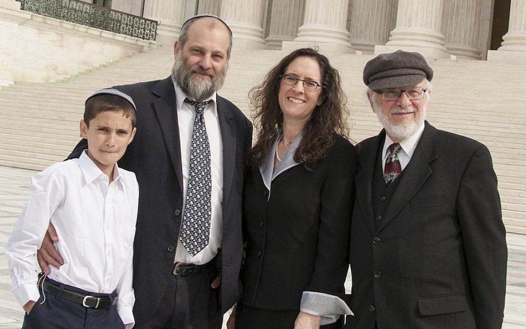 Menachem Zivotofsky, left, and his father Ari posing in front of the Supreme Court with their attorney Alyza Lewin and Lewin's father Nathan, November 3, 2014 (Rikki Gordon Lewin)