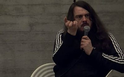 Controversial German performance artist Jonathan Meese addressing an audience on January 21, 2012. (screen capture: YouTube)