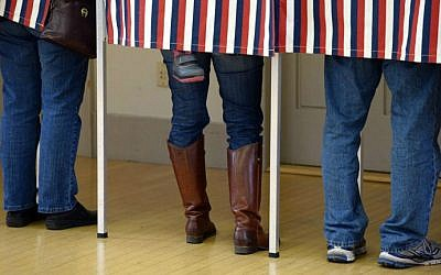 Voters cast their ballots at Madbury Town Hall November 4, 2014 in Madbury, New Hampshire (photo credit: Darren McCollester/Getty Images/AFP)