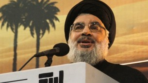 Hassan Nasrallah speaks in a rare public appearance addressing thousands of his supporters ahead of the Shiite Ashura commemorations on November 3, 2014, in the Lebanese capital's southern suburbs. (photo credit: AFP PHOTO/STR)