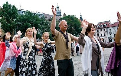 Revelers dancing at the Jewish Culture Festival in Krakow, one of many Jewish culture festivals in Poland. (Photo credit: Wojciech Karlinski)