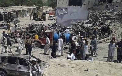 Afghanis survey the damage of a suicide bombing at a market in Paktika province in the country's east on July 15, 2014. (screen capture: YouTube)