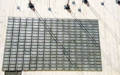 A wall of plaques featuring the names of 265 Jewish army veterans from around the world (photo credit: Jessica Steinberg/Times of Israel)