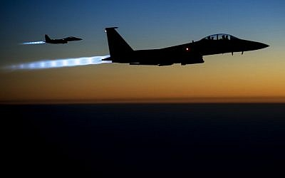 A pair of US Air Force F-15E Strike Eagles fly over northern Iraq after conducting airstrikes against Islamic State targets in Syria on Sept. 23, 2014. (US Air Force/Senior Airman Matthew Bruch)