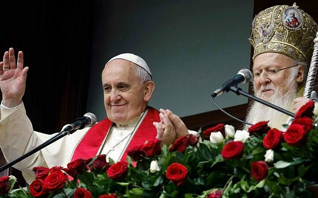 Pope Francis, left, and Ecumenical Patriarch Bartholomew I bless the faithful gathered in the courtyard of the Patriarchal Church of St. George, in Istanbul, Sunday, Nov. 30, 2014. (photo credit: AP Photo/Gregorio Borgia)