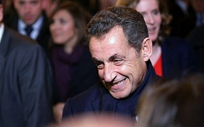 Former French President Nicolas Sarkozy leaves his headquarters, in Paris, Saturday, Nov. 29, 2014. (photo credit: AP Photo/Thibault Camus)