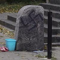 The Babi Yar memorial in Kiev, Ukraine, is defaced with swastikas, in September 2014. (Screenshot/YouTube)