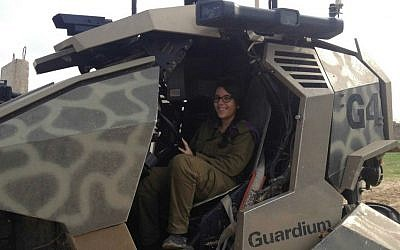 Pvt. May Krispin in a Mark I unmanned ground vehicle (photo credit: Mitch Ginsburg/ Times of Israel)