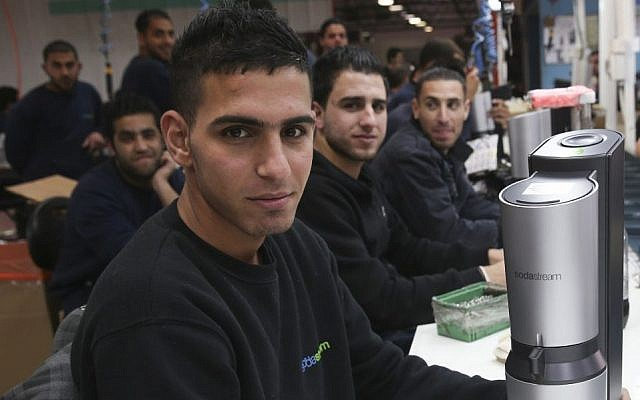 Palestinian employees at SodaStream's West Bank factory (Photo credit: Nati Shohat/Flash90)