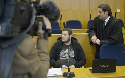 A photo taken on September 15, 2014 shows Kreshnik Berisha (center) with his lawyer on trial for terror-related charges at the Higher Regional Court in Frankfurt am Main, Germany. (photo credit: AFP/ Thomas Kienzle)