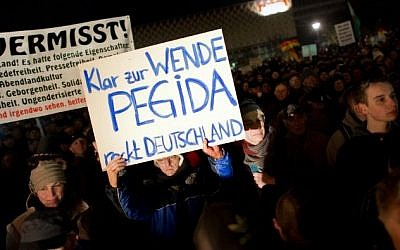 Supporters of the PEGIDA movement -- Patriotic Europeans against the Islamization of the Occident -- during a rally in Dresden, Germany, on December 8, 2014 (photo credit: AFP/DPA/Arno Burgi)