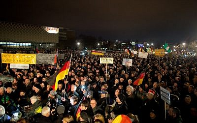 Supporters of the PEGIDA movement take part in a rally in Dresden, eastern Germany, on December 15, 2014. (photo credit: AFP/DPA/Arno Burgi)