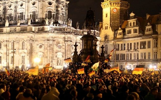 "Protesters of the ""Patriotic Europeans Against the Islamization of the Occident"" (PEGIDA) demonstrate in Dresden, eastern Germany, on December 22, 2014.  (photo credit: AFP/Kay Nietfield)"