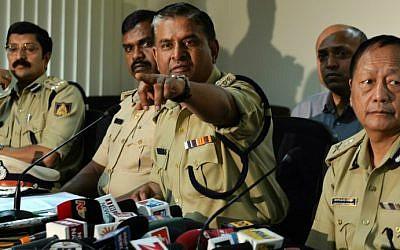 Bangalore City Police Commissioner, M.N. Reddy gestures while speaking on the arrest of the 'jihadi tweeter' in Bangalore on December 13, 2014. (photo credit: AFP photo/Manjunath Kiran)
