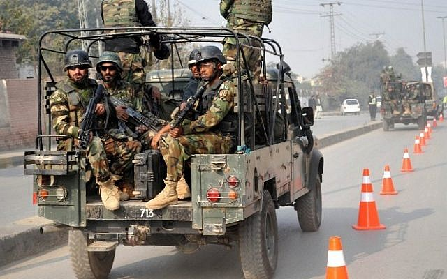 Pakistani troops reach the site of an attack by Taliban gunmen on a school in Peshawar on December 16, 2014.  (photo credit: AFP/A MAJEED)