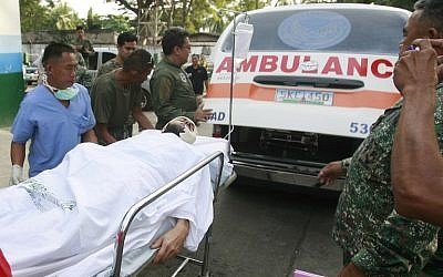 Swiss man Lorenzo Vinciguerra arrives on a stretcher at a military hospital, following his rescue from Abu Sayyaf abductors, on the southern island of Jolo, Mindanao, on December 6, 2014. (photo credit: AFP)
