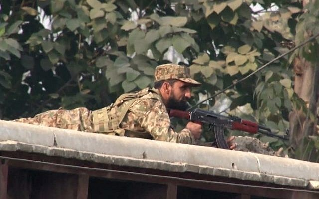 A Pakistani soldier taking up a position following an attack on a school by Taliban gunmen in Peshawar on December 16, 2014. (photo credit: AFP/Aftab Ahmed)