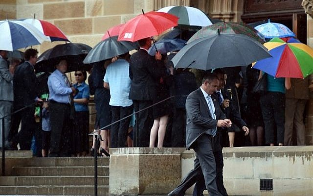 Visitors enter the Great Hall at the University of Sydney for the memorial service of Katrina Dawson in Sydney on December 23, 2014. (Peter Parks/AFP)