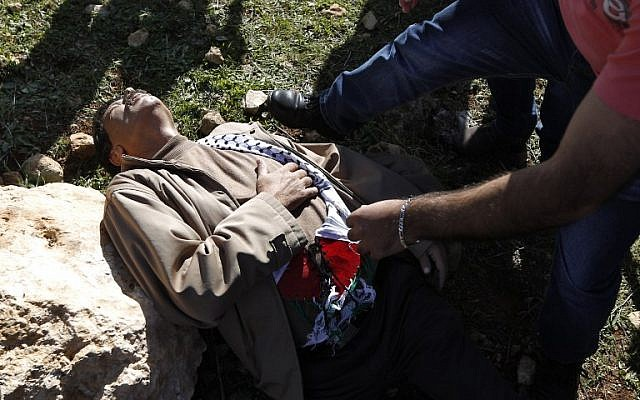 Palestinian official Ziad Abu Ein after a scuffle with Israeli forces during a demonstration in the West Bank on Wednesday, December 10, 2014 (photo credit: AFP/ABBAS MOMANI)