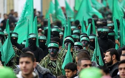 Palestinian members of the Izz ad-Din al-Qassam Brigades, the armed wing of Hamas, at a rally to commemorate the 27th anniversary of the Islamist movement's creation, at the Nuseirat refugee camp in the Gaza Strip, on December 12, 2014. (AFP/Said Khatib)