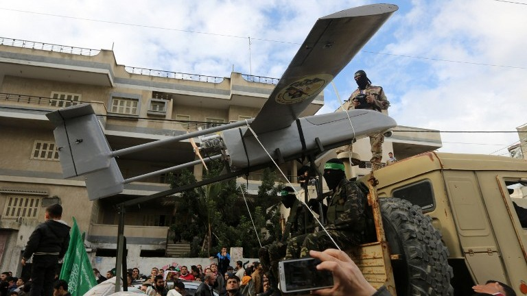 Members of the al-Qassam Brigades, Hamas's armed wing, display a drone during a parade marking the 27th anniversary of the Islamist movement's creation on December 14, 2014 in Gaza City. (AFP/Mahmud Hams)