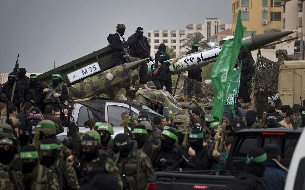 Members of the al-Qassam Brigades, Hamas's armed wing, display weapons during a parade marking the 27th anniversary of the Islamist movement's creation on December 14, 2014 in Gaza City. (photo credit: AFP/MAHMUD HAMS)