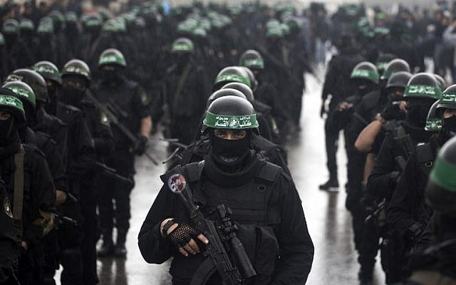 Members of the al-Qassam Brigades, Hamas's armed wing, take part in a parade marking the 27th anniversary of the Islamist movement's creation on December 14, 2014 in Gaza City. (photo credit: AFP/Mahmud Hams)
