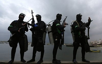 Palestinian divers from the al-Qassam Brigades, Hamas' armed wing, take part in a parade marking the 27th anniversary of the Islamist movement's creation on December 14, 2014 in Gaza City. (photo credit: AFP/ MAHMUD HAMS)
