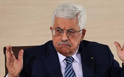 Palestinian Authority President Mahmud Abbas speaks during a press conference in Algiers on December 23, 2014. (photo credit: AFP PHOTO / FAROUK BATICHE)