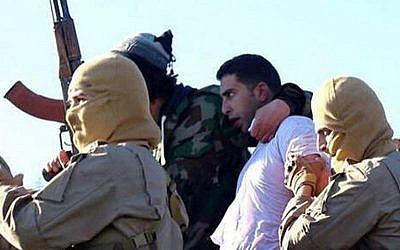 A still image released by the Islamic State's branch in Raqqa, Syria on jihadist websites on December 24, 2014 purportedly shows Jordanian pilot First Lieutenant Mu'ath al-Kaseasbeh. (AFP/HO/ Welayat Raqa)